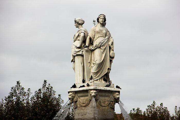 Three Female Figures On Top Of Fontaine de la Rotonde In Aix-en-Provence