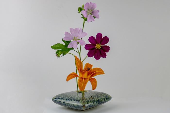 Ikebana Flowers Against A White Background