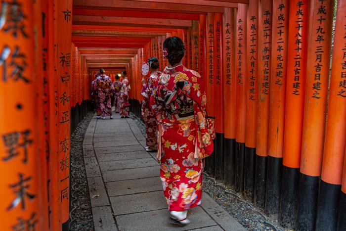 Woman Walking In Fushimi Inari Taisha Japan